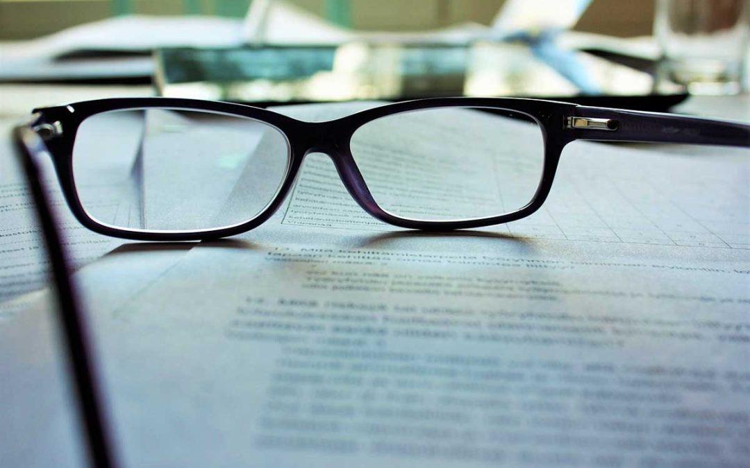 glasses on documents image - Pixabay